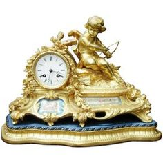 French 19th Century Bronze Gilt Mantel Clock with Porcelain Panels