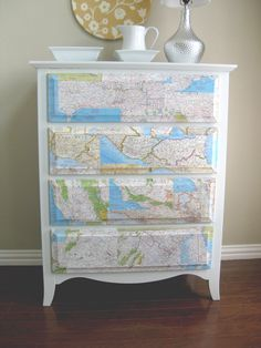 okay, maybe not a map, but you could decoupage anything on a drawer front..scrapbook paper, pretty fabric, book pages, etc. cute idea for all those beat up dressers we see at garage sales and thrift stores.