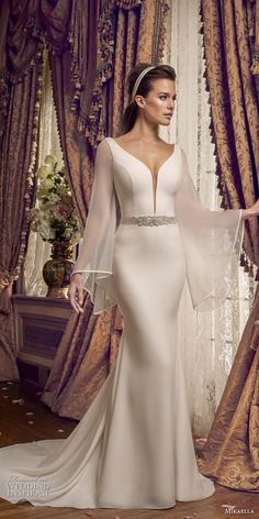 mikaella fall 2017 bridal long angel sleeves deep plunging v neck simple clean chic elegant fit and flare wedding dress open v back chapel train mv -- Mikaella Fall 2017 Wedding Dresses Bridal Party Dresses, Wedding Dress Styles, Bridal Gowns, Long Sleeve Wedding, Wedding Dress Sleeves, Dresses With Sleeves, Sleeve Dresses, Long Dresses, Mikaella Bridal