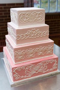 Pink ombre 4 tier wedding cake with white detailing