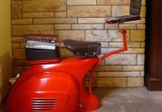 I want to work on this Vespa workstation made with half a 1968 Vespa half of the day. Then chill out the other half of the day on the chair made with the other half of the Vespa. A brilliant mashup. Car Furniture, Upcycled Furniture, Furniture Design, Aviation Furniture, Compact Furniture, Automotive Furniture, Furniture Ideas, Computer Station, Computer Workstation