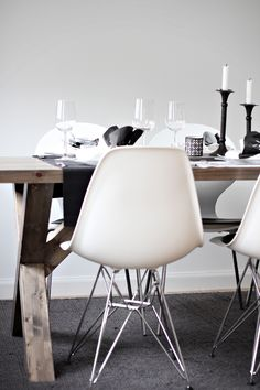 rustic wooden dining table with Eames chairs
