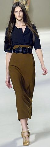 instead it is a high waisted long skirt like the brown calf-length by Chloe, it can make a thin, long- torsoed woman proportionate and curvy. Such skirts look equally good on medium or tall women. A well-cut long skirt can hug you at all the right places: the satin black number seen below can be an asset to any curvy tall woman's wardrobe