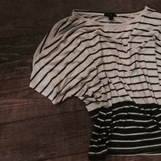 Forever 21 Striped Oversized Shirt Oversized shirt but still has some form. Bigger up top and goes a bit tighter towards the bottom. Light material Forever 21 Tops Tees - Short Sleeve
