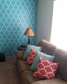 A DIY stenciled turquoise living room accent wall using the Marrakech Trellis Stencil from Cutting Edge Stencils. http://www.cuttingedgestencils.com/moroccan-stencil-marrakech.html