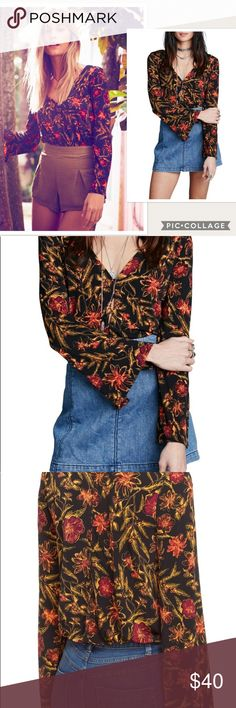"NWT Free People Martini Bell Sleeves Floral Top Vibrant floral blooms illuminate the darkened background of a bohemian-inspired top made with voluminous bell sleeves and a relaxed silhouette. #117 Bust : 42""  Material: 95% Polyester/ 5% Spandex Fabric Type: Polyester Free People Tops Blouses"