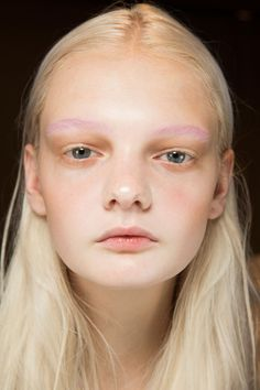 Yadim bleached most models' brows at Gucci, before painting them peach, yellow, pink, lilac or white. Skin was natural-looking and eyes lined with beige.