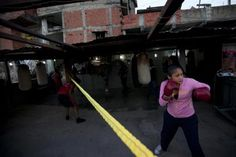 Maleiwa Perdomo, 12, practises Olympics-style street boxing during a training session at a gym in the low-income neighborhood of La Vega in Caracas February 10, 2011.  REUTERS/Carlos Garcia Rawlins