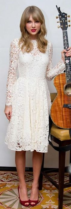 Who made  Taylor Swift's white lace dress and red suede platform pumps?