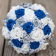 Royal blue wedding bouquet, royal blue and silver bouquet, horizon blue bouquet,. Blue Wedding Flowers, White Wedding Bouquets, Silver Flowers, Wedding Blue, Wedding Dresses, Royal Blue And Gold, Blue And Silver, Popular Wedding Colors, Trendy Wedding
