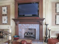 An Isokern fireplace with herringbone brick pattern. House Styles, Herringbone Fireplace, House Interior, Herringbone Brick Pattern, Brick, Fireplace, Wainscoting, Brick Fireplace, Home Decor