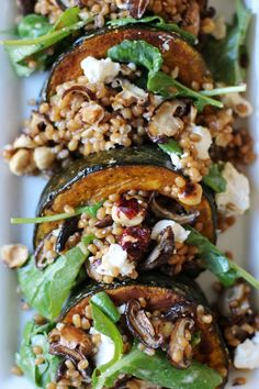 kabocha squash salad. Packed with hazelnuts, arugula, shiitakes, and feta, with a delicious tahini based dressing. Yum!