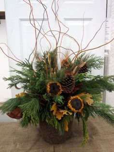 Growing Place - Want to decorate your porch but don't want it to be too Christmas-y for Thanksgiving. It's easy--using greens, dried and preserved fall accents like sunflowers and oak leaves, and wheat you can create a beautiful fall container. Then, after Thanksgiving, switch out the sunflowers and oak leaves for glitter branches and a festive bow and Voila! You're ready for the holidays!