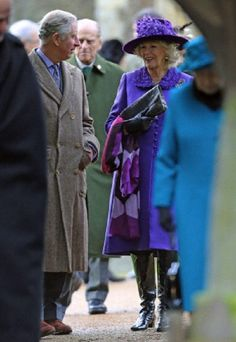 Members of Britain's royal family gather for their traditional family Christmas Day church service with Britain's Prince Charles, left, and his wife Camilla the Duchess of Cornwall, and Prince Philip seen centre behind, at St Mary Magdalene Church