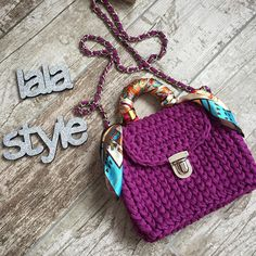 Handbag made of natural yarn (cotton) and quality fittings. Inside sewn lining with a pocket. Bag decorated with scarf and complete with a long chain. Size: length 19 centimeters, height 18 centimeters, width 10 centimeters. Made with love.