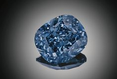 Blue Moon, a cushion-cut 12.03-carat diamond of perfect proportions, is a masterpiece of mother nature enhanced by the hands of man.