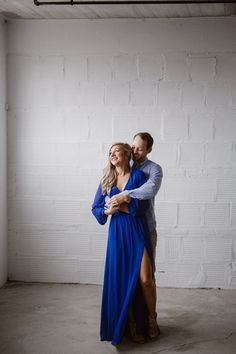 This gorgeous blonde bride-to-be wore a fantastic cobalt blue dress with a slit for her industrial engagement photos in a warehouse. I love the pop of color against the white stone walls. Photographed by Knoxville Engagement Photographer Erin Morrison Photography www.erinmorrisonphotography.com #knoxvilleweddingphotographer #knoxvillewedding #urbanwedding #urbanengagementphotos #erinmorrisonphotography Engagement Dresses, Engagement Session, Urban Engagement Photos, Blonde Bride, Engagement Photographers, Cobalt Blue Dress, Gorgeous Blonde, Stone Walls, Photo Blue
