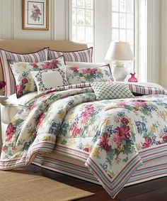 dress your bed with the charming melinda comforter set featuring a floral design with stripe border and a reverse stripe pattern complement this set with