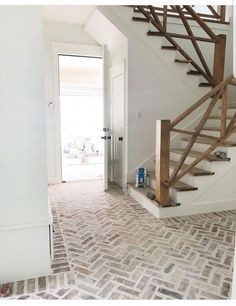 Gorgeous wood stairs and brick entry way. 2019 Gorgeous wood stairs and brick entry way. The post Gorgeous wood stairs and brick entry way. 2019 appeared first on House ideas. Brick Tile Floor, Brick Pavers, Brick Flooring, Brick Look Tile, Brick Floor Kitchen, White Flooring, Diy Flooring, Painted Stairs, Wood Stairs