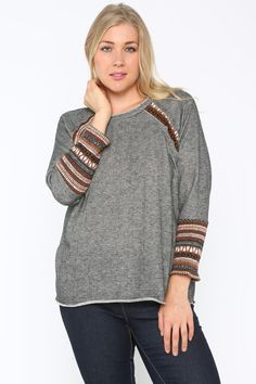 Tribal Pullover Sweater-Plus Sizes. Long sleeve sweater with tribal trim detailing on sleeve and neckline portion of garment. $26.99