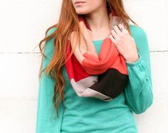 This color block infinity scarf is super cute. It would look good paired with a plain shirt weather it be long sleeve, short sleeve, tank top, dolmen sleeve or any plain shirt you want. It would also look cute with any bottoms that will match the shirt and scarf and not look to busy. Some examples are colored or patterned denim(shorts, jeans, skirts), patterned leggings, skirts or any other type of pants you have as long as they match and don't look busy.