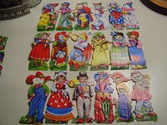 These are adorable cats dressed up in assorted attire and costume. Each row measures about 6 1/2 long and 3 tall. Great for scrapbook, handmade