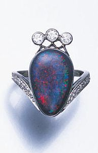 A black opal and diamond ring, the pear-shaped black opal, within a plain rub-over mount, to a stylised old brilliant-cut diamond coronet surmount, with tapering diamond shoulders and a finely pierced gallery