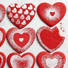These heart cookies are cute-as-can-be thanks to a flurry of powdered sugar. Get the free heart stencils at www.bhg.com/HeartCookie.