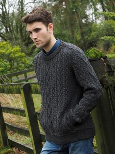 Men's Aran Sweater with pockets also has the button shoulder detail which creates and extra element of style. Ultimate soft luxury Men's sweater in great colours. An Irish Aran Sweater designed with comfort in mind perfect for a casual day. This Irish wool sweater is traditionally crafted with original Aran stitches. It's the perfect Men's sweater