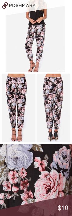 Volcom floral noir harem pants Volcom floral noir harem pants in black with soft pink, slate blue, white, green and gray allover floral print. Lightweight, breezy woven viscose material. Elastic waistline and cuffed ankles. True harem pants style with draped fabric between thighs. These are so pretty. Excellent condition (posh purchase that was never worn). Size Large. Volcom Pants Ankle & Cropped