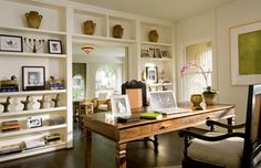 I love the white walls and dark floor in the creative work space!