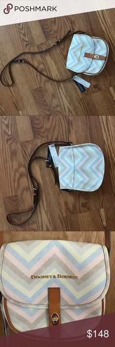 Dooney & Bourke Pastel Chevron Crossbody Field Bag Authentic Dooney Pastel Chevron Crossbody Field Bag NWT. Turn-lock closure & exterior back slip pocket. Interior two slip pockets and backwall zip pocket. Light blue lining and key keeper. Measurements: 7H x 8L x3W with 22in adjustable strap drop. Feel free to ask questions. No trades. Reasonable offers consider, submit one today ❣️ Dooney & Bourke Bags Crossbody Bags