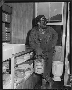 Miner who is shopping with his family in the subsidiary company store. This store carries a large selection of good quality merchandise at prices competitive with chain stores. U.S. Coal and Coke Company, Gary Mines, Gary, McDowell County, West Virginia., 08/17/1946