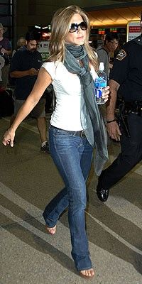 Plain white t, jeans, sunglasses, comfy shoes, and a pashmina.  Easy and chic travel.