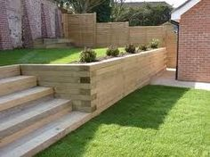 The use Railway Sleepers can make a huge difference to your landscaping project…. The use Railway Sleepers can make a huge difference to your landscaping project. Use them to create borders, walls, garden steps and Relevantly cheap to buy Sleeper Retaining Wall, Wood Retaining Wall, Garden Retaining Walls, Retaining Wall With Steps, Landscaping Retaining Walls, Railway Sleepers Garden, Oak Sleepers, Landscape Design, Garden Design