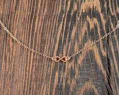 -set of 2-5 necklaces or individual necklaces -14k Rose Gold Fill -16 inch necklace The infinity is a wonderful symbol that can represent karma, infinite potential, and can be a symbol of love and friendship. These dainty rose gold infinity necklaces are a great gift for your girlfriend, bridesmaids, or just for your bff. Or you can just get one for yourself. At the center of each necklace is a hand formed, infinity symbol made from 14k rose gold fill with matching chain and spring ring…