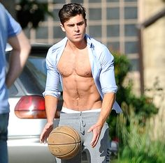 Zach Effron plays basketball shirtless on the set of the Townies on May 7, 2013.
