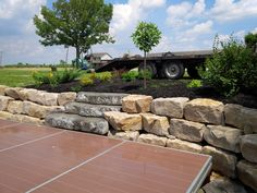 Large stone retaining wall surrounding a dock