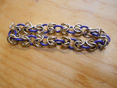 136.  Brass and purple EPDM rubber rings. Stretchy Byzantine pattern bracelet. $10