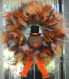 Thanksgiving Turkey Wreath by CraftyCrystalDesigns on Etsy, $65.00    SO GONNA MAKE SOMETHING SIMILAR OF MY OWN, THIS IS TOO STINKING CUTE WITH THE TULLE AND FEATHERS!
