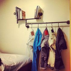 Apartment Decorating on a Budget - love this industrial minimalist shelf!!