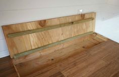 The space underneath floorboards often goes untapped, and can be a great spot for storing items you don't use often. Access them with trap door.