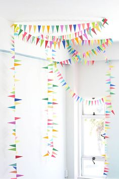 This DIY Rainbow Triangle Bunting would make a darling statement for a Baby Einstein themed birthday party! Party Girlande, Bunting Garland, Diy Bunting, Rainbow Bunting, Garlands, Buntings, Paper Bunting, Bunting Ideas, Rainbow Paper