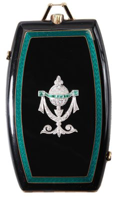 "Diamond, Emerald and Enamel Compact - Lot 153 of September 2012 Auction -   Art Deco rectangular tonneau-shaped compact, black opaque enamel with inner ""emerald"" green guilloche enamel, 42 single-cut diamonds bead set on the applied white gold urn and swag detail, estimated combined diamond weight .29 cts, color F-G, clarity VS, accented with 10 rectangular and square mixed cut emeralds, estimated combined emerald weight .80 cts., 3 1/4 x 1 7/8 in., - Estimate $2,000 to $3,000"