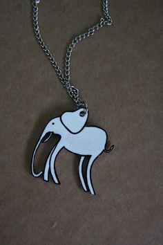 Dali Inspired Elephant Shrinky Dink Necklace  #ecrafty @Kim at eCrafty.com #shrinkydinks  #shrinkjewelry #shrinkcharms