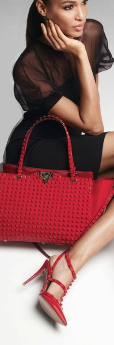 Joan Smalls and Valentino Bag Already have a bag similar to this in blue& green. ...need the red though lol