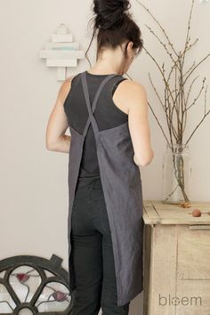 Here is a lovely hand made linen apron in a slate grey color tone.  The back is a simple cross over, this way the apron is easily put on over the head and doesnt need buttons or wraps around the waist. Loose fit and open on the back for easy sitting and bending over when working for instance in the garden.  The aprons are available in sizes XS-S size bust size around 84 cm / 33.1 inches length from shoulder to knee 94 cm / 37 inches  M size bust size around 88 cm / 34.6 inches length from…