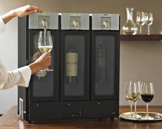 Williams Sonoma's wine gadgets provide the serving and storing solutions. Find electric wine openers and wine pourers that complement any collection of wine accessories. Wine Gadgets, Cool Kitchen Gadgets, Cool Kitchens, Kitchen Tools, Wine Dispenser, Armoire, Wine Chiller, Up House, Family Kitchen