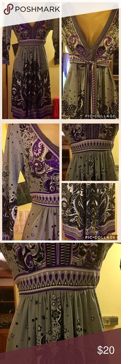 SPECTACULAR VERSATILE DRESS xs but also fits small Gorgeous purple, grey, and black V-neck dress with tie in back.  The V neck is in both the front and the back.  Perfect for dress up for a party, or a cover up at the beach or pool side, or put on some flip flops and sit by a fire 🔥 on a cool summer evening!  Or wear when it's colder out with leggings or tights!  xs but fits a small as well.  If it fit me it would not be leaving my closet! Dresses Midi