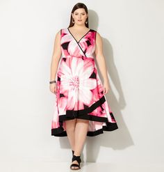 Try new trends in spring hemlines with our plus size Floral Envelope Dress available online at avenue.com. Avenue Store